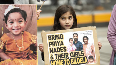 A young girl takes part in a rally supporting the family in Melbourne on Sunday