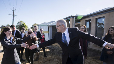 Scott Morrison and Nicolle Flint, the Liberal candidate for Boothby in Adelaide, visiting a hew housing estate to promote the Coalition's first home buyer plan.