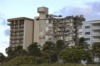 Sinking in the 1990s: debris dangles from Champlain Towers South Condo after the multistory building partially collapsed.