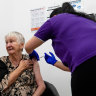 A doctor for the cameras - but nurses do heavy-lifting for vaccine rollout