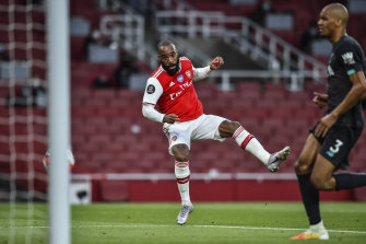 Arsenal's Alexandre Lacazette scores his team first goal during the English Premier League soccer match between Arsenal and Liverpool at the Emirates Stadium.
