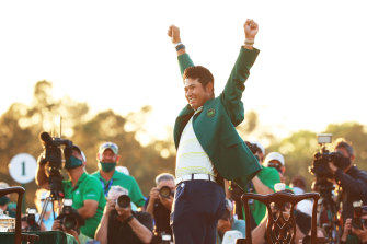 AUGUSTA, GEORGIA - APRIL 11: Hideki Matsuyama of Japan celebrates during the Green Jacket Ceremony after winning the Masters at Augusta National Golf Club on April 11, 2021 in Augusta, Georgia. (Photo by Mike Ehrmann/Getty Images)