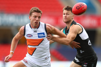 Aidan Corr and Robbie Gray compete for the ball on Sunday.