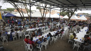 Venezuelan migrants eat at a migrant shelter near Cucuta, Colombia, on the border with Venezuela last year. The shelter serves about 4500 free lunches daily.