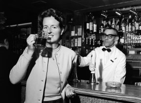 Daily Mirror photographer Doreen Spooner drinking beer for a feature in the Daily Mirror, 1962.
