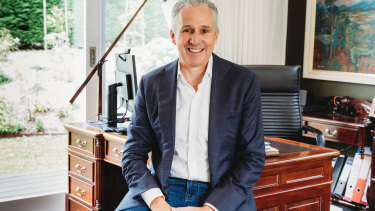 Telstra boss Andy Penn spoke to businesspeople from his home office in Melbourne on Thursday.