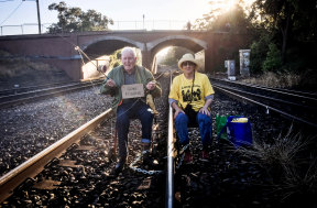 Bill Ryan and Susie Gold locked to Carrington Railway in Newcastle, an action he took at the age of 96.