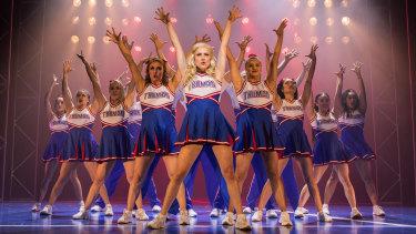 Kirby Burgess leads the Truman cheerleaders.