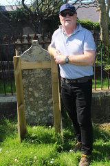 Steve Foley at the grave of his great-great-grandmother, Janet Pole Williamson, in the Knab Road Cemetery, Lerwick, Shetland.