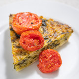 Spinach, feta and rice tart with tomatoes.