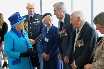 The Queen meets wing commander Paul Farnes (centre) and others in 2015.