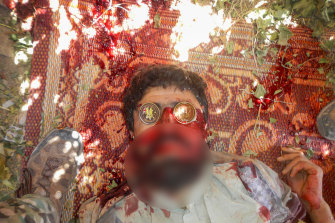 A dead suspected Taliban fighter on whose eyes were placed two souvenir Australian military coins.