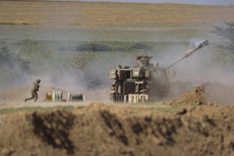 An Israeli artillery unit fires toward targets in Gaza Strip from the Israeli border on Saturday.
