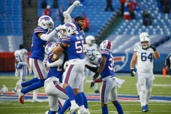 Matt Milano (No.58) celebrates with Bills teammates after their drought-breaking win.