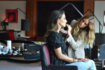 Change of pace ... make-up artist Jade Kisnorbo (right) working on Lainey McIntyre at the 2019 Brownlow.