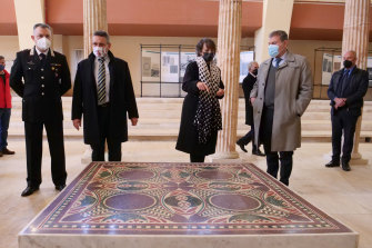 Authorities stand around a 1.5 square metre mosaic dating back to 40 AD, belonging to Caligula's lavish ceremonial ships.