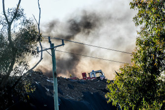 Black smoke was seen billowing from the tip fire.