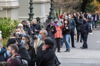 Lines of people wait to be vaccinated at the Exhibition Building in Carlton on Thursday.