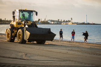 Cleaners finish up the clean-up after New Year's Eve celebrations at St Kilda beach on Wednesday morning.