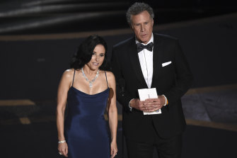 Julia Louis-Dreyfus, left, and Will Ferrell present the award for best cinematography.