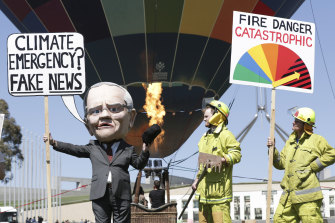 A climate change rally takes place on the front lawn of Parliament House on Tuesday as a motion to declare a climate emergency was voted down.