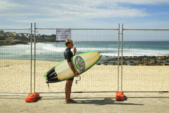 A surfer at fenced-off Bronte Beach in Sydney's east last month.