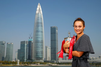 Ashleigh Barty with the trophy after her victory in the WTA Finals in Shenzhen last year. This year's tournament has been cancelled.