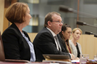 Auditor-General Grant Hehir, centre, will be able to add 52 staff to the audit office after receiving a funding increase.