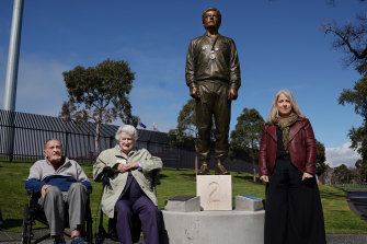Janita Norman (right) poses with her grandmother Thelma Norman and coach Neville Sillitoe alongside the statue of Peter Norman.