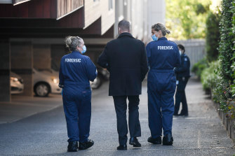 Homicide detectives and forensics officers examined the scene at the Richmond apartment on Saturday morning.