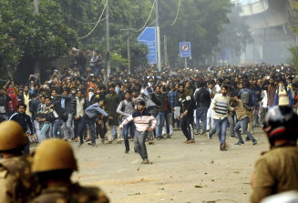 Students protest outside Jamia Millia Islamia University in New Delhi.