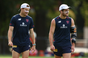 Angus Brayshaw (right) with his arm brace at training on Monday.