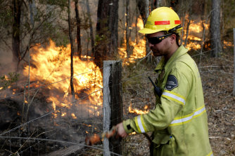 Forestry Corporation worker Eric Jackson working on a fire at Old Bar on the NSW North Coast in November.