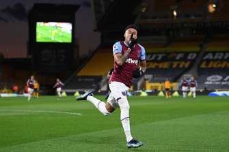Jesse Lingard celebrates scoring West Ham's first goal.