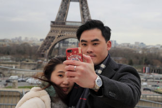 There are fewer Chinese visitors posing in front of the Eiffel Tower in recent weeks.