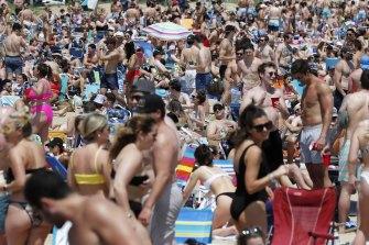 Crowds gather in a beach in South Boston in June 2021.