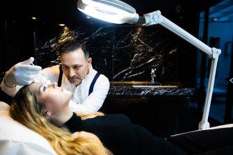 Dr Joseph Hkeik treats a patient for facial injectables.