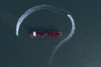 Aerial view of an Iranian Revolutionary Guard speedboat moving around a British oil tanker in the Strait of Hormuz on July 21.