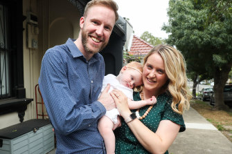 Cara and Adam Steggles with eight-month-old daughter Evie who was born after three rounds of IVF.