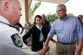 Prime Minister Scott Morrison and NSW Premier Gladys Berejiklian with RFS Commissioner Shane Fitzsimmons arriving on Sunday at the Picton Bowling Club, which is being used as a evacuation centre.