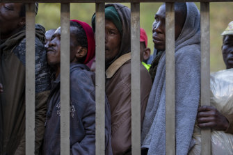 Homeless people queuing for a meal and a shelter in Hillbrow, Johannesburg, South Africa, during a nationwide lockdown.