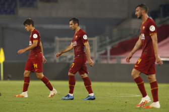 Roma's Gonzalo Villa and his teammates Henrikh Mkhitaryan and Bryan Cristante trudge off after their Serie A loss to lowly Udinese.