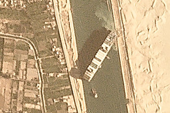 A satellite image shows the vessel wedged in the Suez Canal.