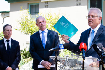 Health Minister Greg Hunt, Aged Care Minister Richard Colbeck and Prime Minister Scott Morrison at the release of the Royal Commission into Aged Care Quality and Safety final report.