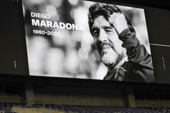 A photo of soccer great Diego Maradona is shown on a large screen during a moment of silence before a match in Seattle, US, on Tuesday.