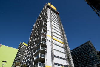Cladding is removed from the Distillery apartment tower in Pyrmont.