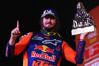 Toby Price celebrates his victory in the Dakar Rally last year.