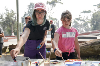Kirby Clark and Emma at the Decks For Change workshop, which helps fund skateboard parks in countries such as Iraq and Nepal.