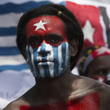 A Papuan student protests in Medan on August 31 with his face painted in the colours of the banned separatist 'Morning Star' flag.
