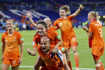 Dutch players celebrate beating Sweden in the semi-finals.